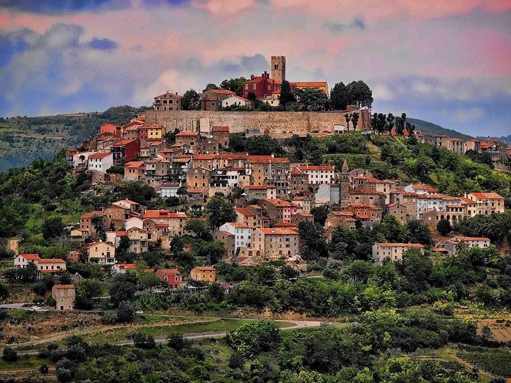 Motovun. I'll live on top of this mountain for 28 blissful days in November. Population 600. Off-season. Surrounded by vineyards. Yes, sunrise photos will happen. Photo from Istria100.com.
