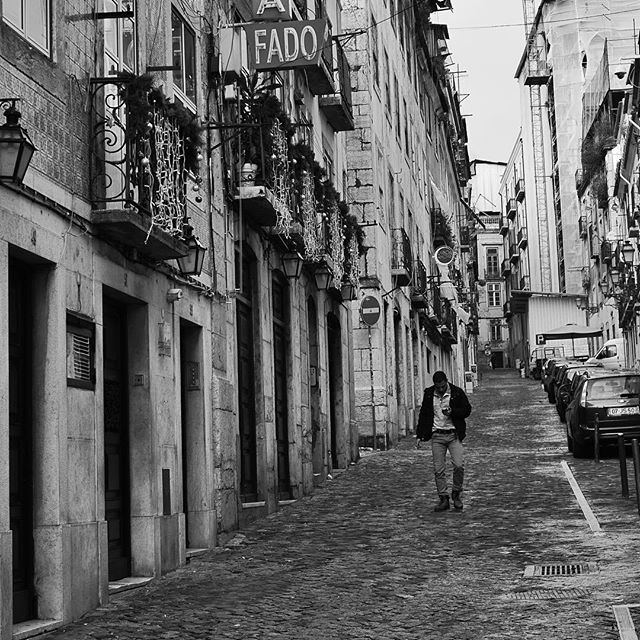 Distracted guy wanders through Lisbon's Barrio Alto. By moi.