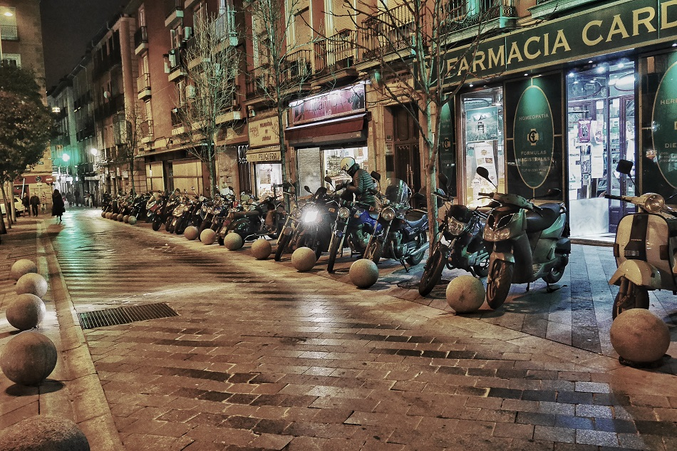 Night-time in Malasana. A line of motorcycles in Madrid.