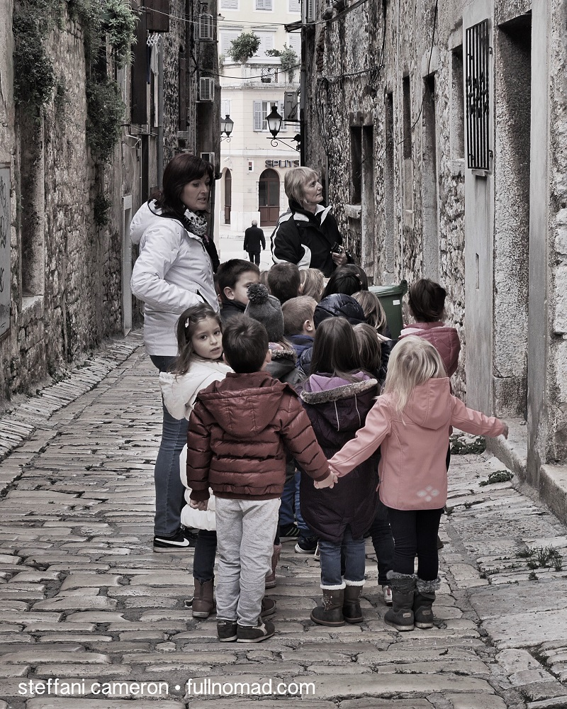 Another blessing of off-season travel is that kids are in school. Now and then you get an adorable treat like this field trip, but it's often quiet. Rovinj, Croatia.