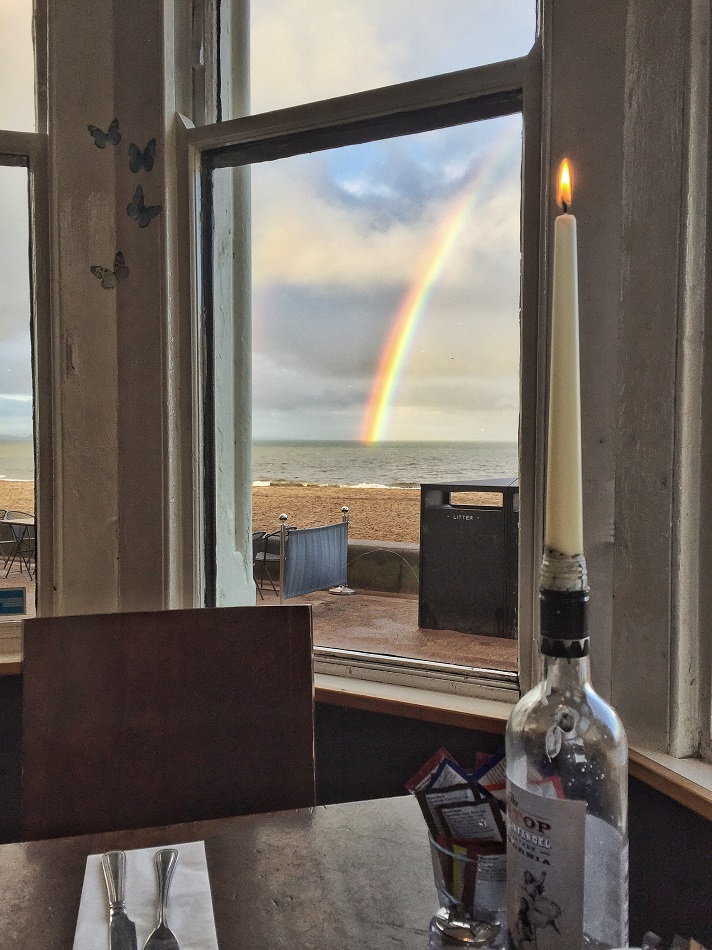 """One of the nicest days of my life. I got on the bus in the wrong direction but got to talk to an elderly lady named Eleanor for 20 minutes who made me smile. I finally went the right way and this was what greeted me at an """"unknown"""" location -- an incredible rainbow, a break before a storm, and a lovely pub where I sat and wote for three hours. Then I walked 5.5 km back to Leith, outside Edinburgh, along the waterfront."""
